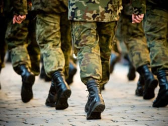 Military service members marching in uniforms