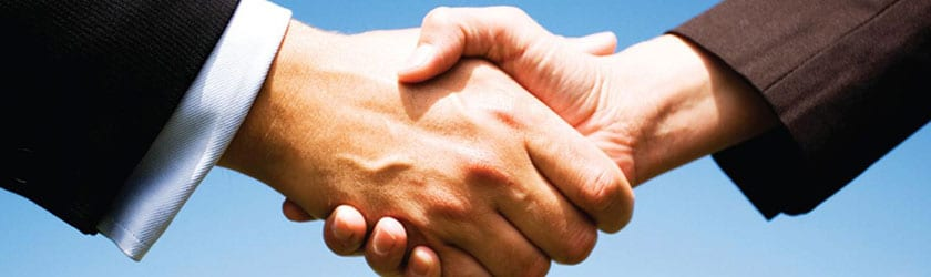 Photo showing two people shaking hands, representing a graduate becoming successful in job placement